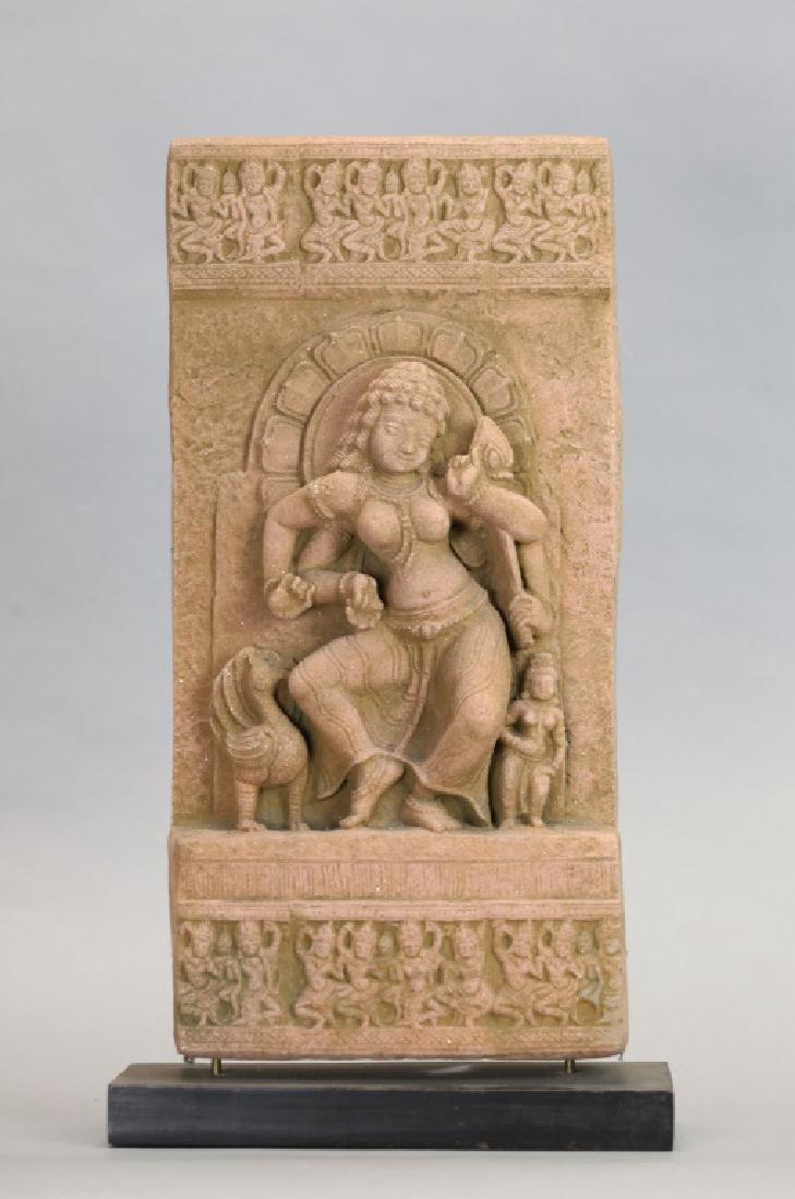 Asian stone stele of a deity