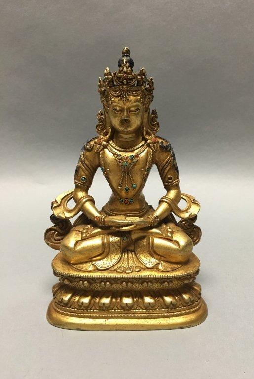 Chinese gilt bronze tara with stones