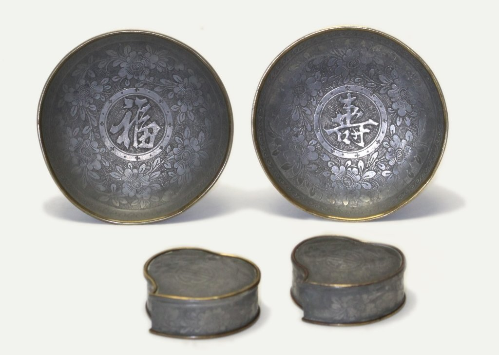 two pairs of Chinese pewter items