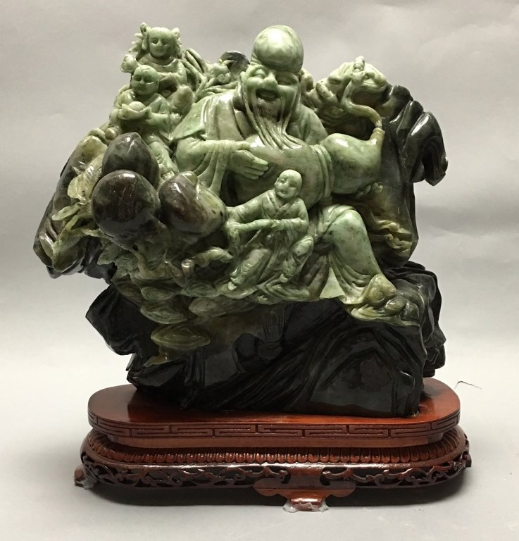 Chinese jade/stone carving of an immortal w/ child