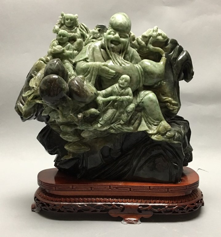 Chinese jade/stone carving of an immortal w/ child - 2