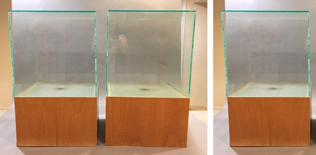 three plexiglass display cases mounted on hardwood