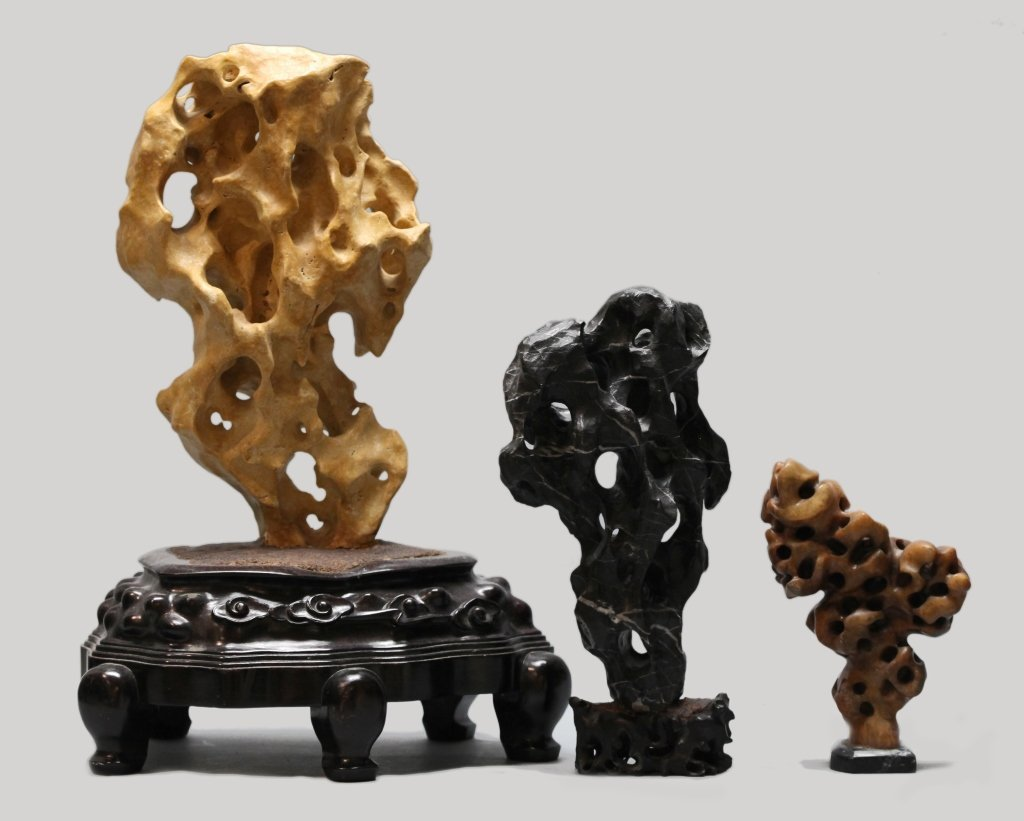 three Chinese scholar rocks on base