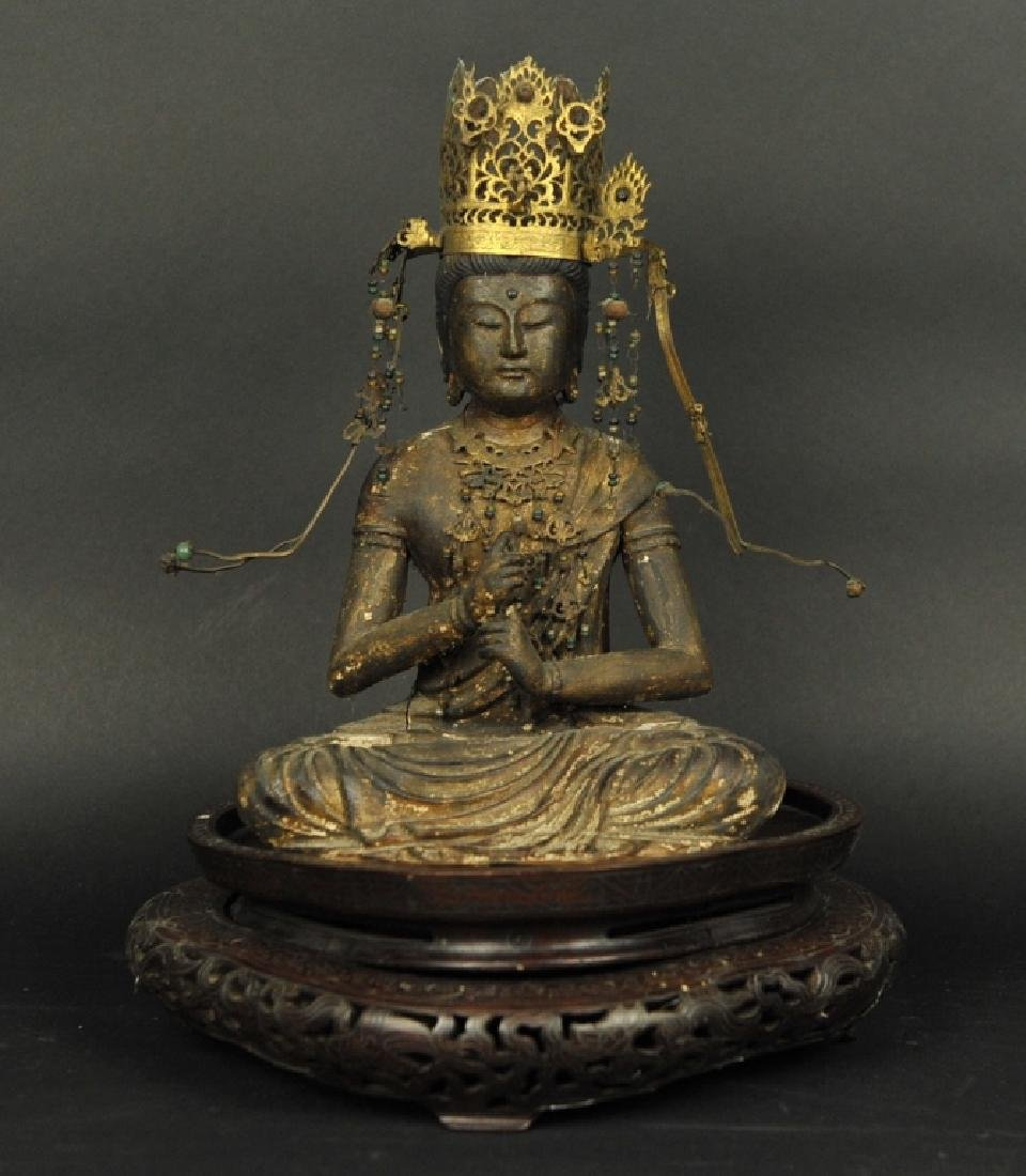 wooden Buddha wearing gilt bronze crown, 19th c.