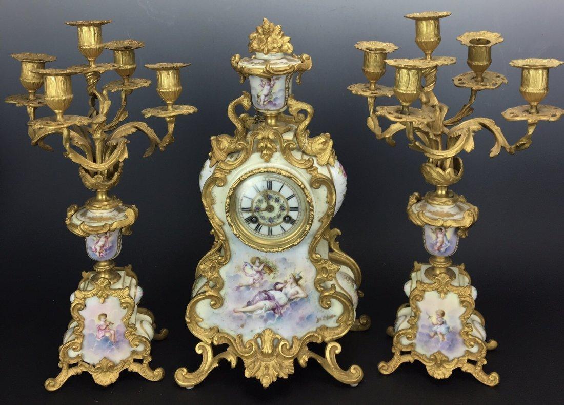 A 19TH CENTURY ORMOLU MOUNTED SEVRES CLOCK SET