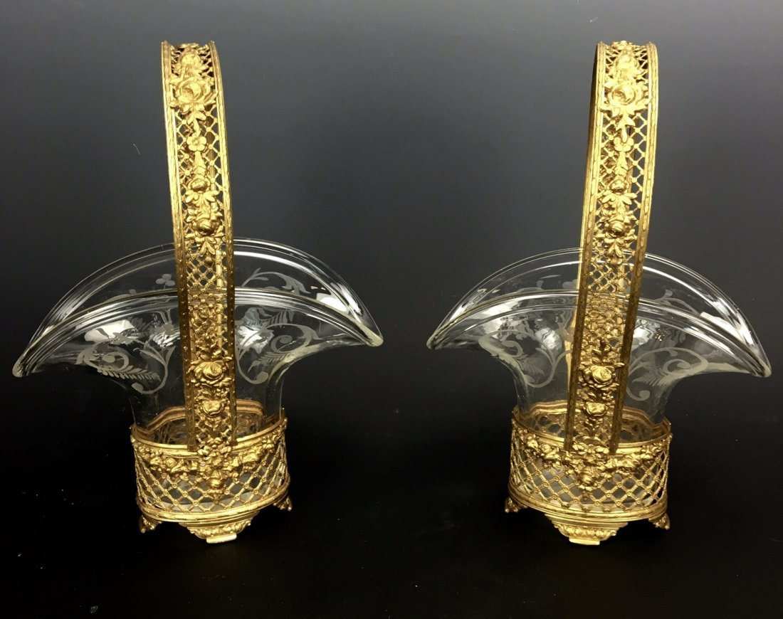 A PAIR OF ETCHED BACCARAT GLASS AND DORE BRONZE BASKETS