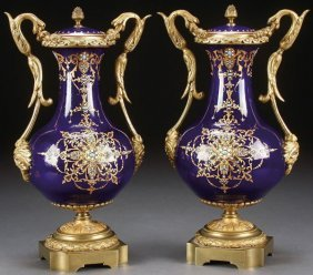 A PAIR OF 19TH CENTURY JEWELLED ENAMEL VASES