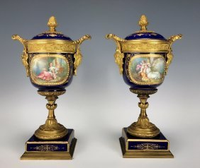 A VERY FINE PAIR OF ORMOLU MOUNTED SEVRES VASES