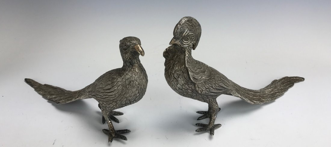 A PAIR OF MEXICAN STERLING SILVER BIRDS
