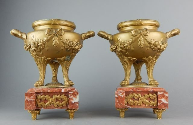 PAIR OF FRENCH GILT VASES ON MARBLE BASES