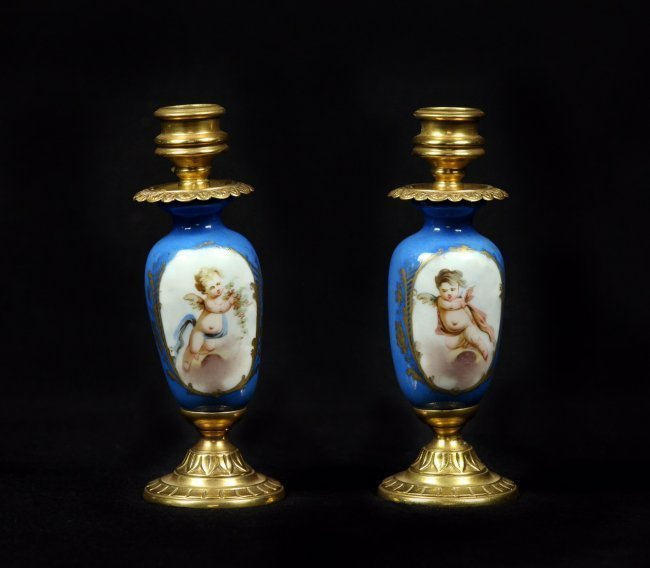 PAIR OF DORE BRONZE AND SEVRES PORCELAIN CANDEL HOLDER