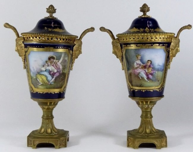 A PAIR OF 19TH CENTURY DORE BRONZE MOUNTED SEVRES VASES