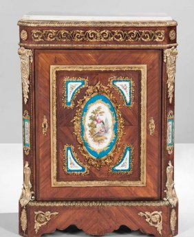 A LOUIS XVI STYLE SEVRES AND ORMOLU MOUNTED COMMODE
