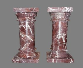 A PAIR OF ROUGE MARBLE PEDESTALS