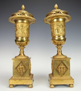 A PAIR OF EARLY 19TH CENTURY RUSSIAN BRONZE VASES
