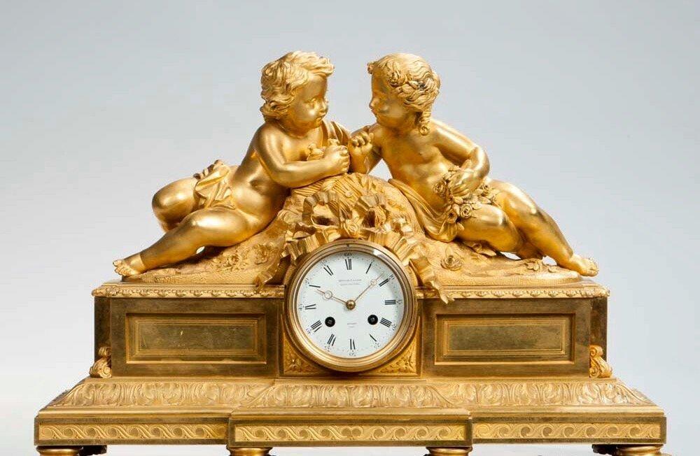 A LARGE 19TH C. DORE BRONZE FIGURAL CLOCK