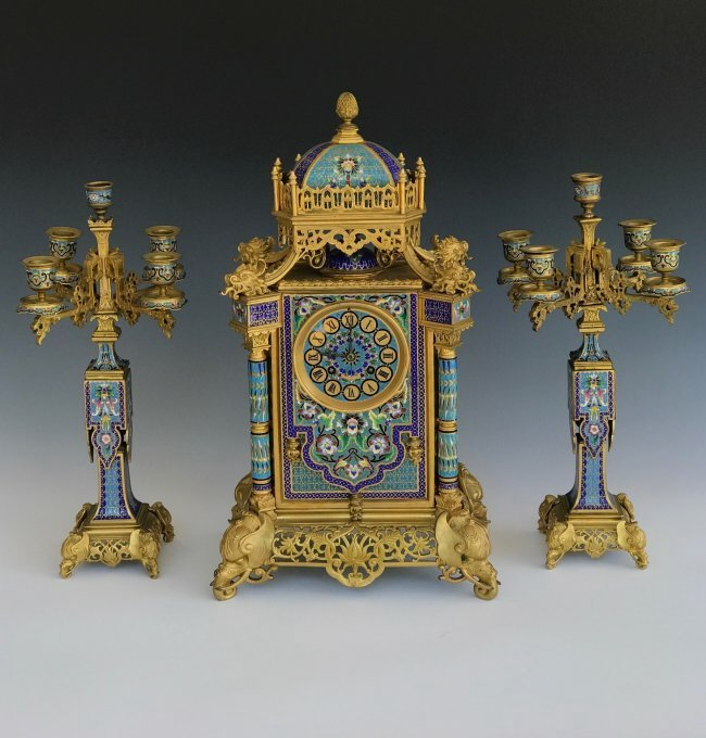 A CHINOISERIE CHAMPLEVE ENAMEL CLOCK SET