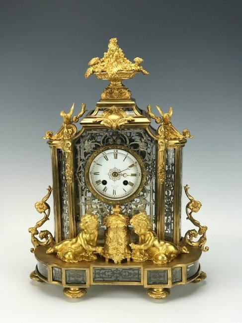 AN OUTSTANDING DORE BRONZE AND CRYSTAL CLOCK