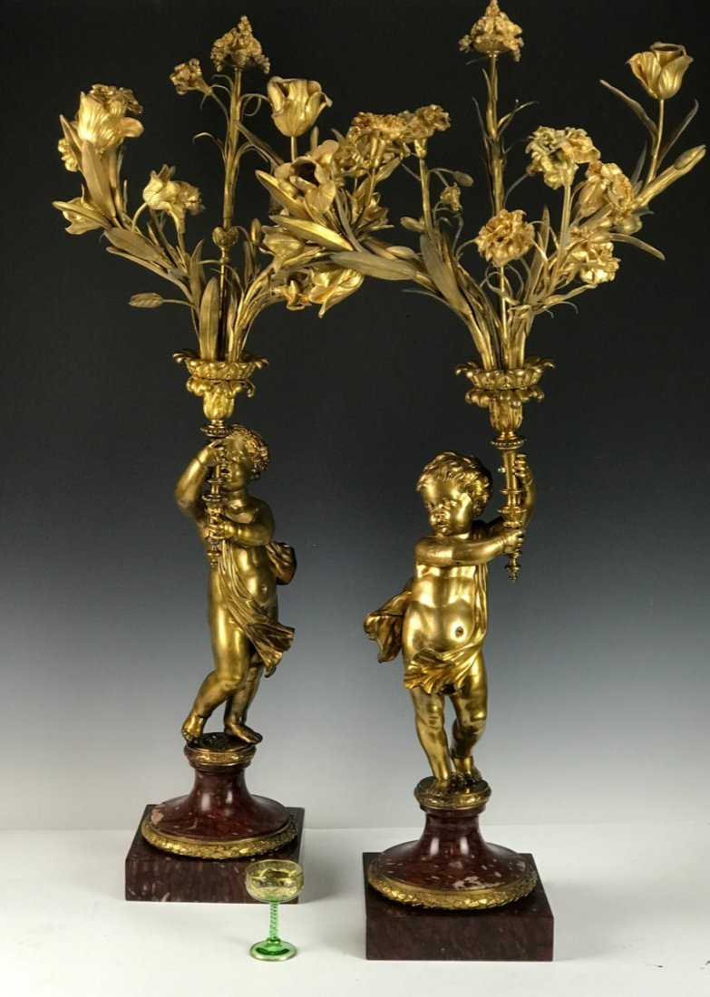 A PALATIAL PAIR OF DORE BRONZE & ROUGE MARBLE CANDELABR
