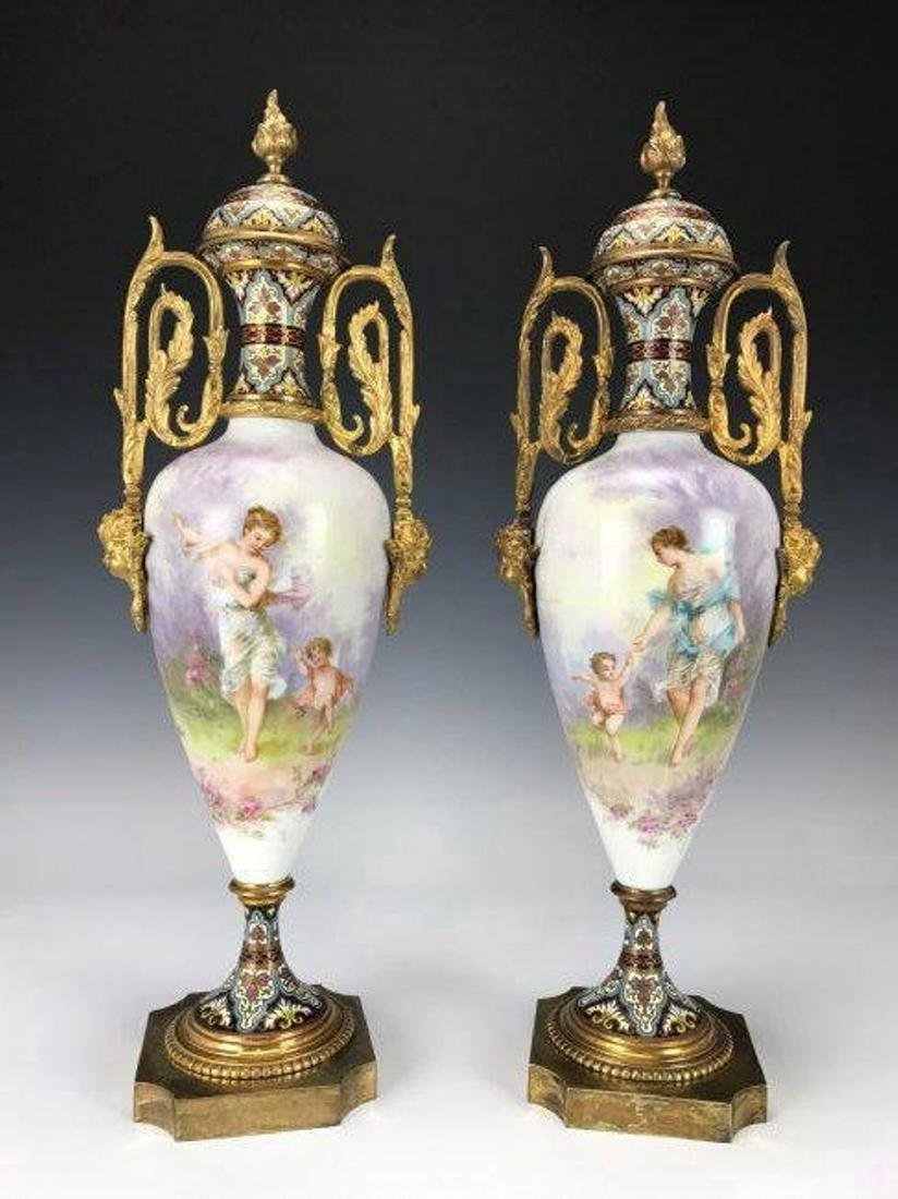 A LARGE PAIR OF FRENCH CHAMPLEVE ENAMEL & SEVRES VASES