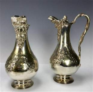 PAIR OF 19TH C SILVERED EWERS