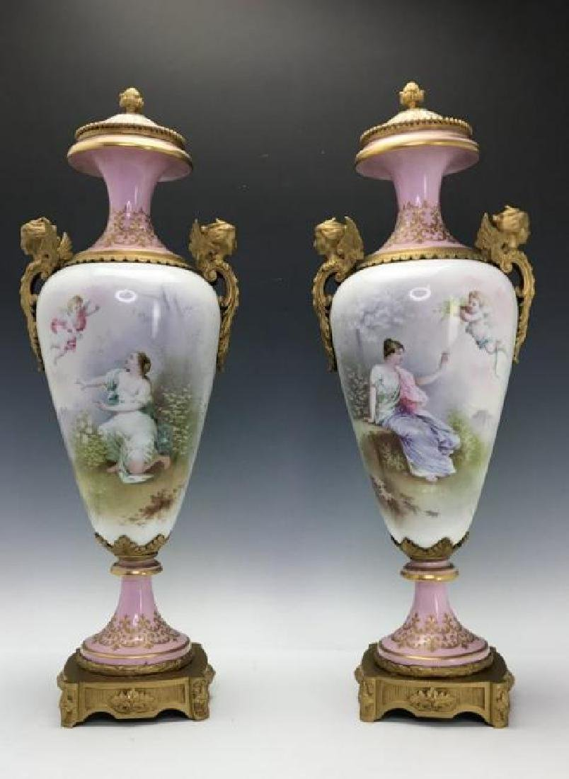 A LARGE PAIR OF ORMOLU MOUNTED SEVRES PORCELAIN VASES
