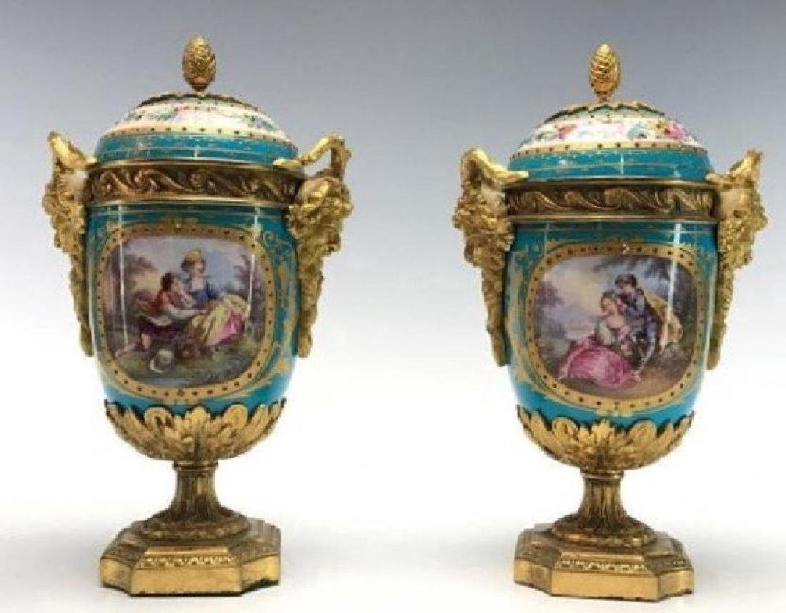 AN IMPOSING PAIR OF JEWELLED SEVRES PORCELAIN VASES