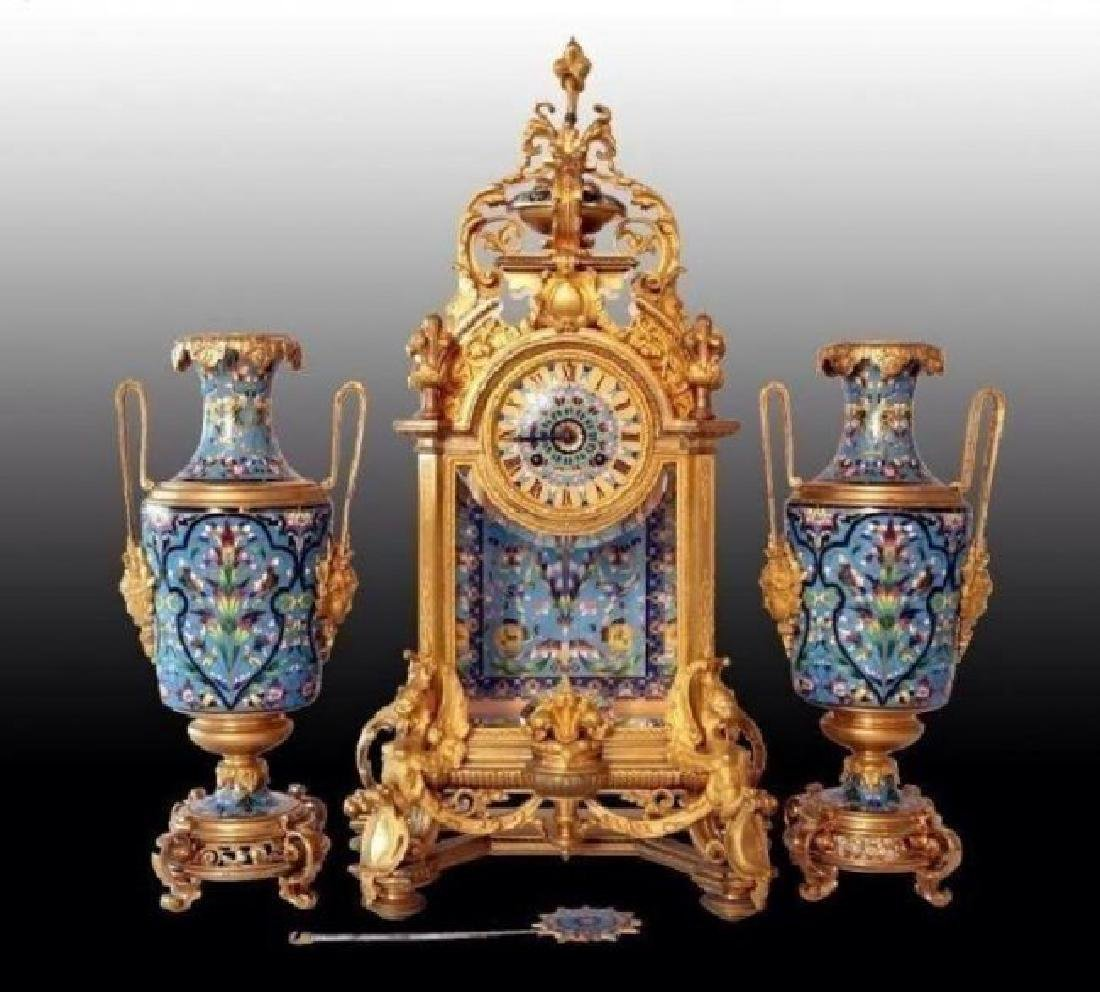 AN IMPOSING FRENCH CHAMPLEVE ENAMEL CLOCK SET