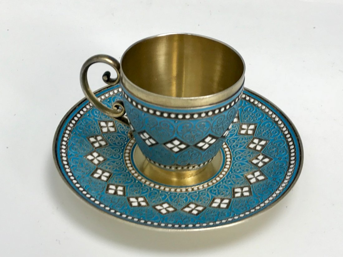 SILVER AND ENAMEL CUP AND SAUCER