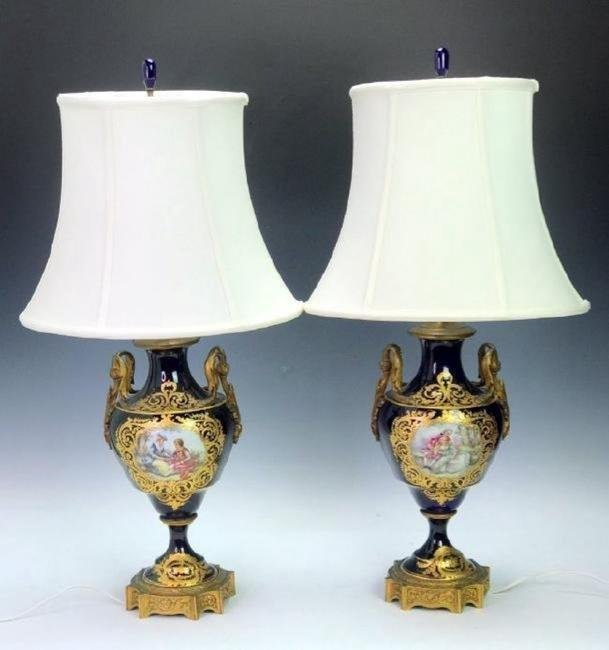 A PAIR OF ORMOLU MOUNTED SEVRES LAMPS
