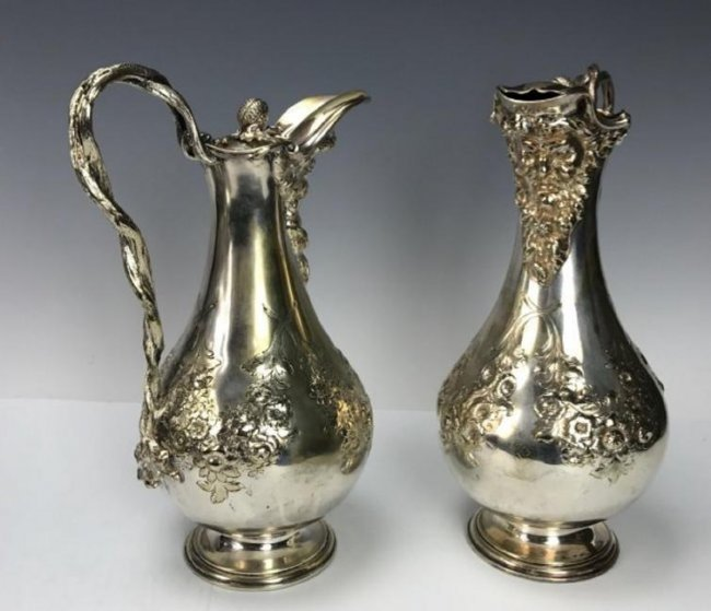 PAIR OF 19TH C. SILVERED EWERS