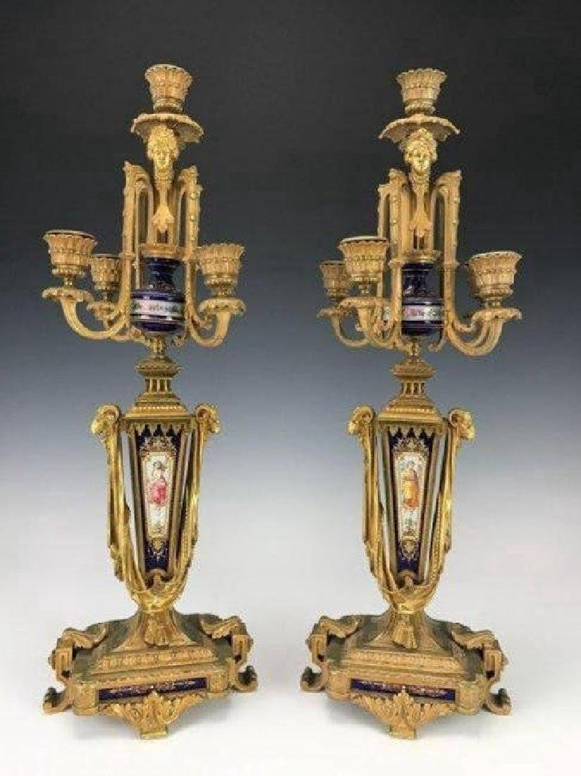 A PAIR OF 19TH C. ORMOLU MOUNTED SEVRES CANDELABRA