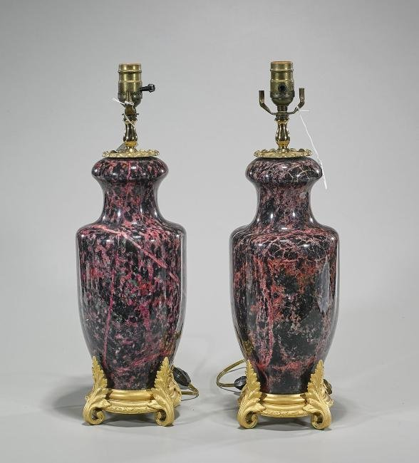 A PAIR OF ORMOLU MOUNTED MARBLE LAMPS