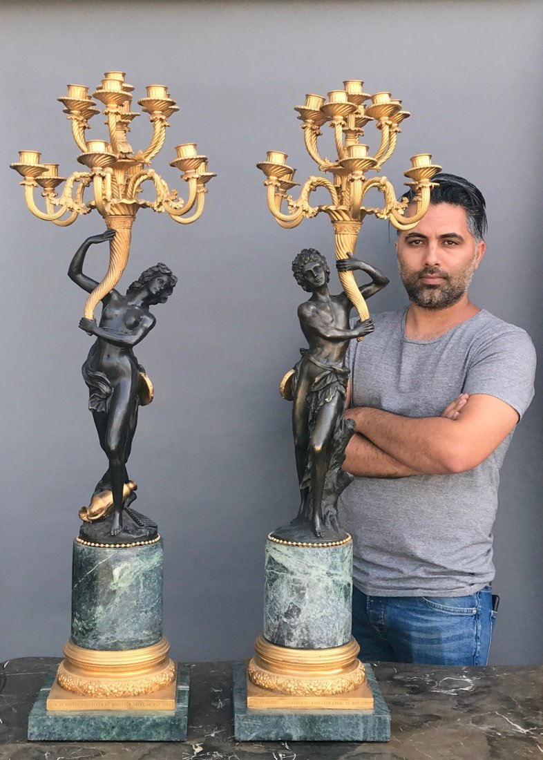 A LARGE PAIR OF BRONZE AND MARBLE CANDELABRA