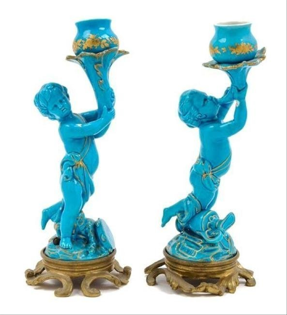 A PAIR OF BRONZE MOUNTED SEVRES CANDELSTICKS