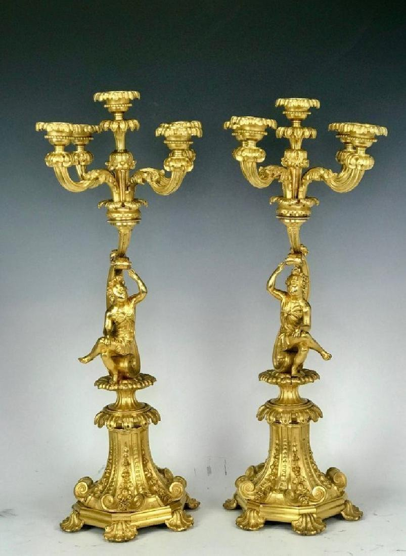 A LARGE PAIR OF DORE BRONZE FIGURAL CANDELABRA