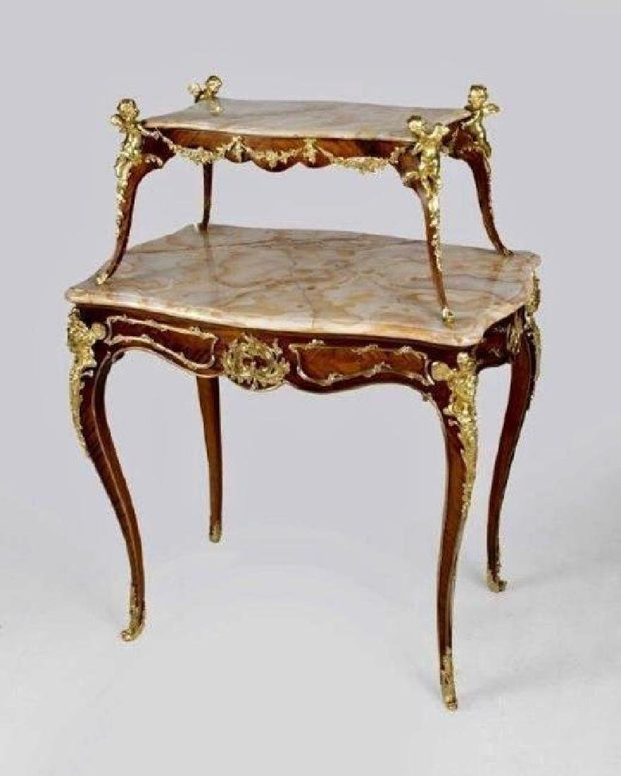 AN ORMOLU MOUNTED MARBLE TOP TEA TABLE BY MAISON MILLET