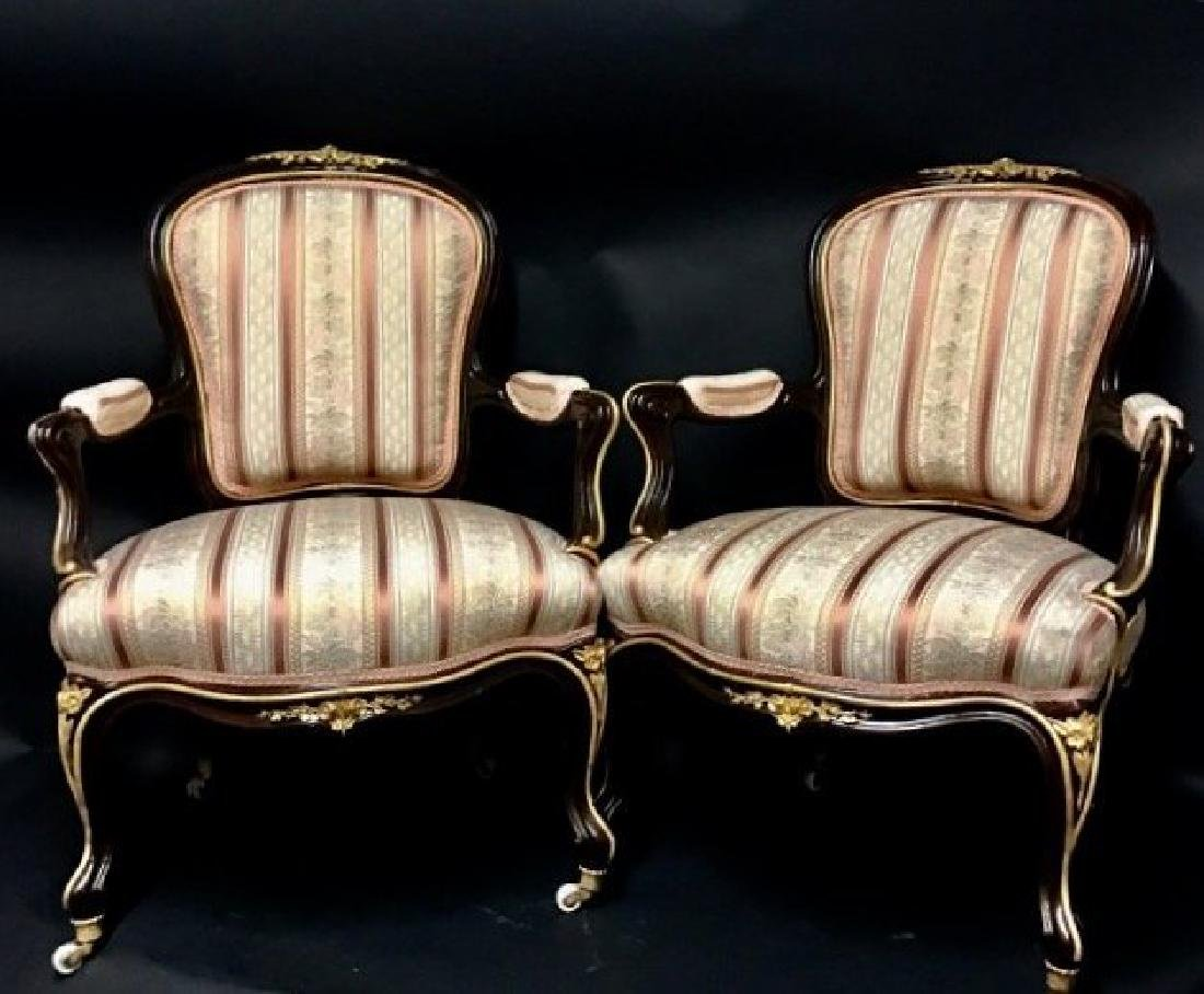 A PAIR OF LOUIS XVI STYLE ORMOLU MOUNTED ARMCHAIRS