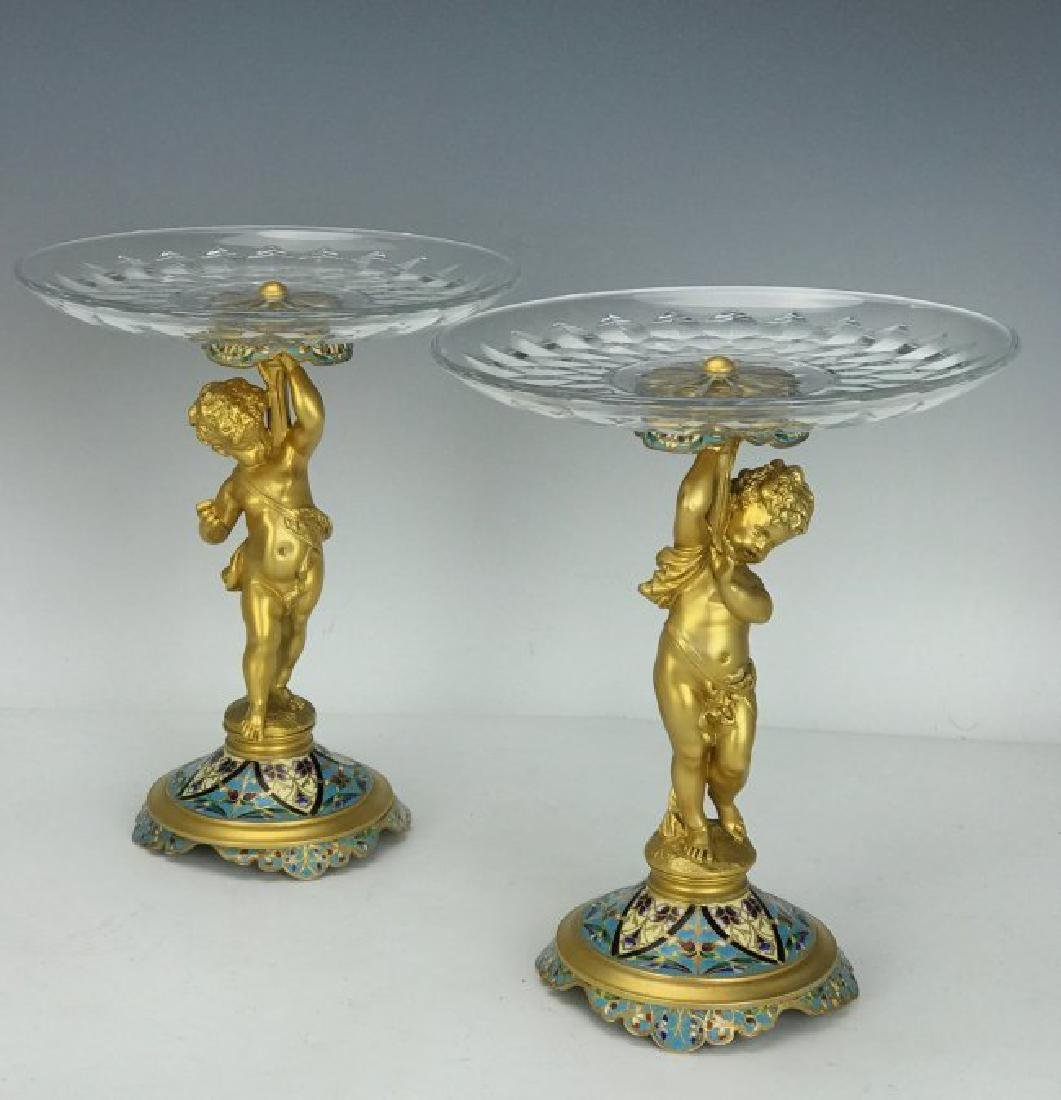 A PAIR OF CHAMPLEVE ENAMEL & BACCARAT GLASS TAZZAS
