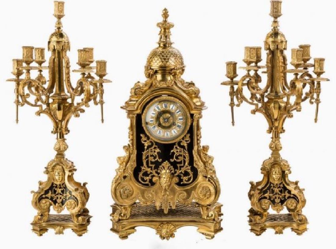 A LARGE LOUIS XVI-STYLE BRONZE THREE-PIECE CLOCK SET
