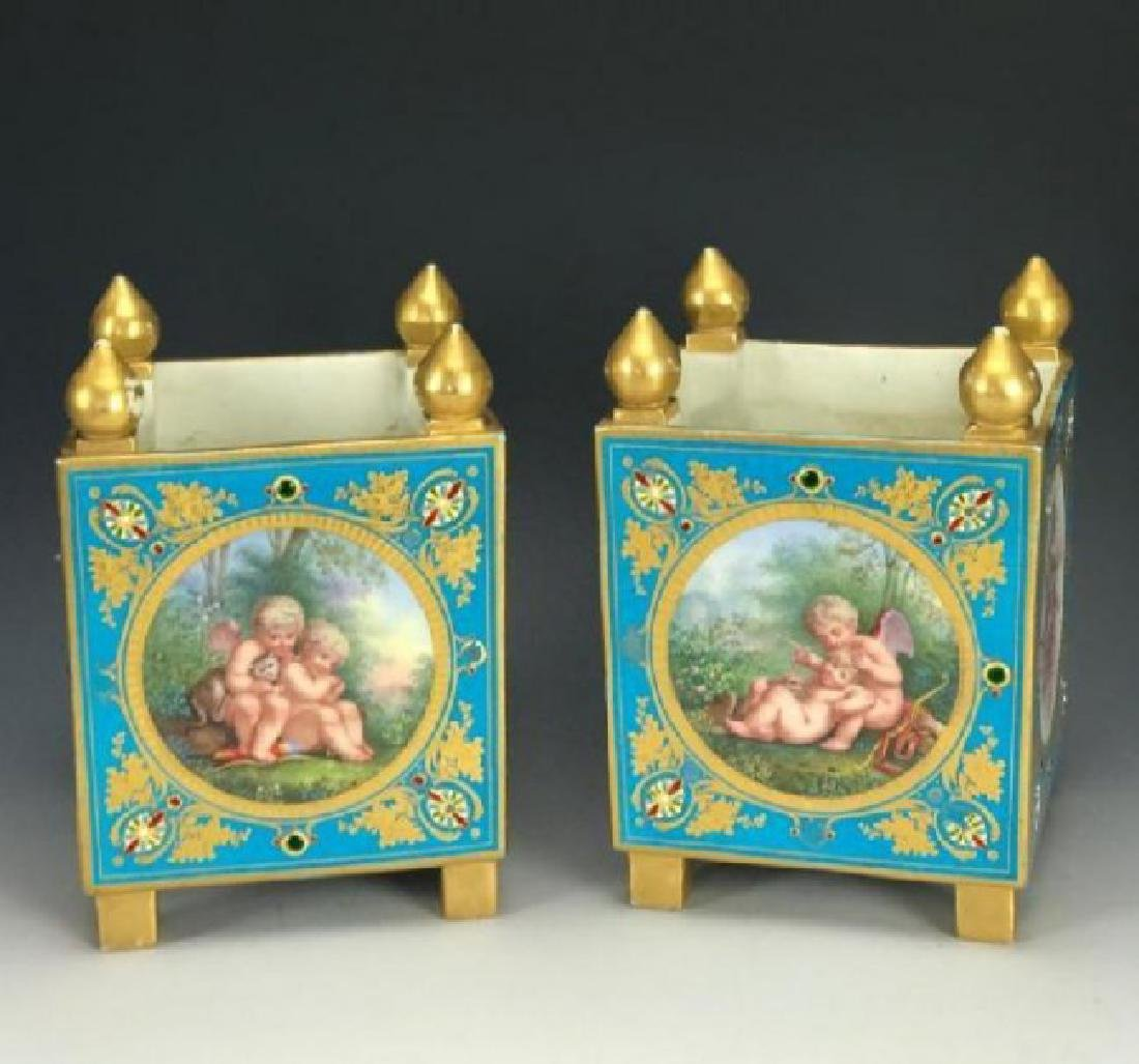 A SUPERB PAIR OF JEWELED SEVRES PORCELAIN CACHEPOTS