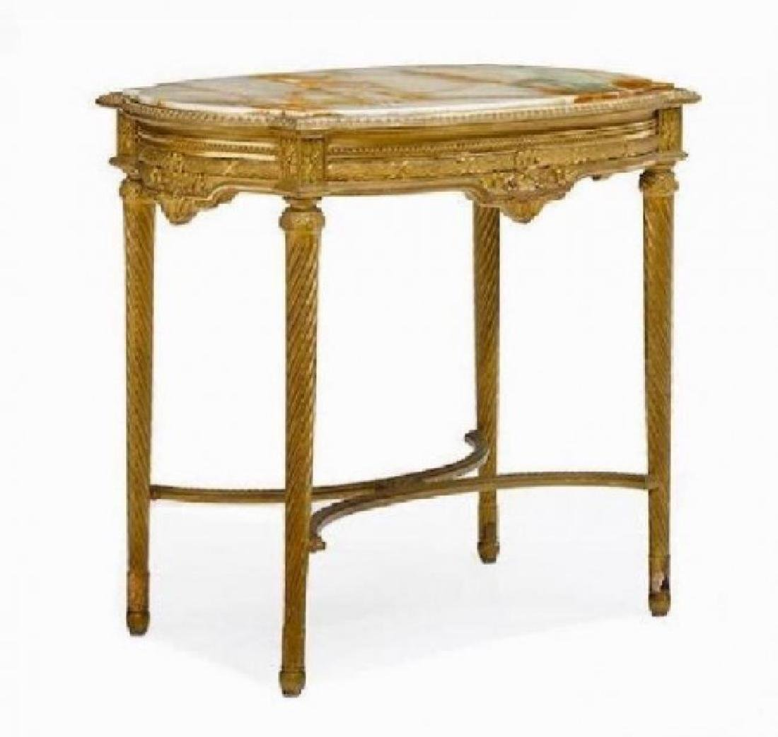 A LOUIS XVI STYLE GILTWOOD AND ONYX TABLE DE MILIEU