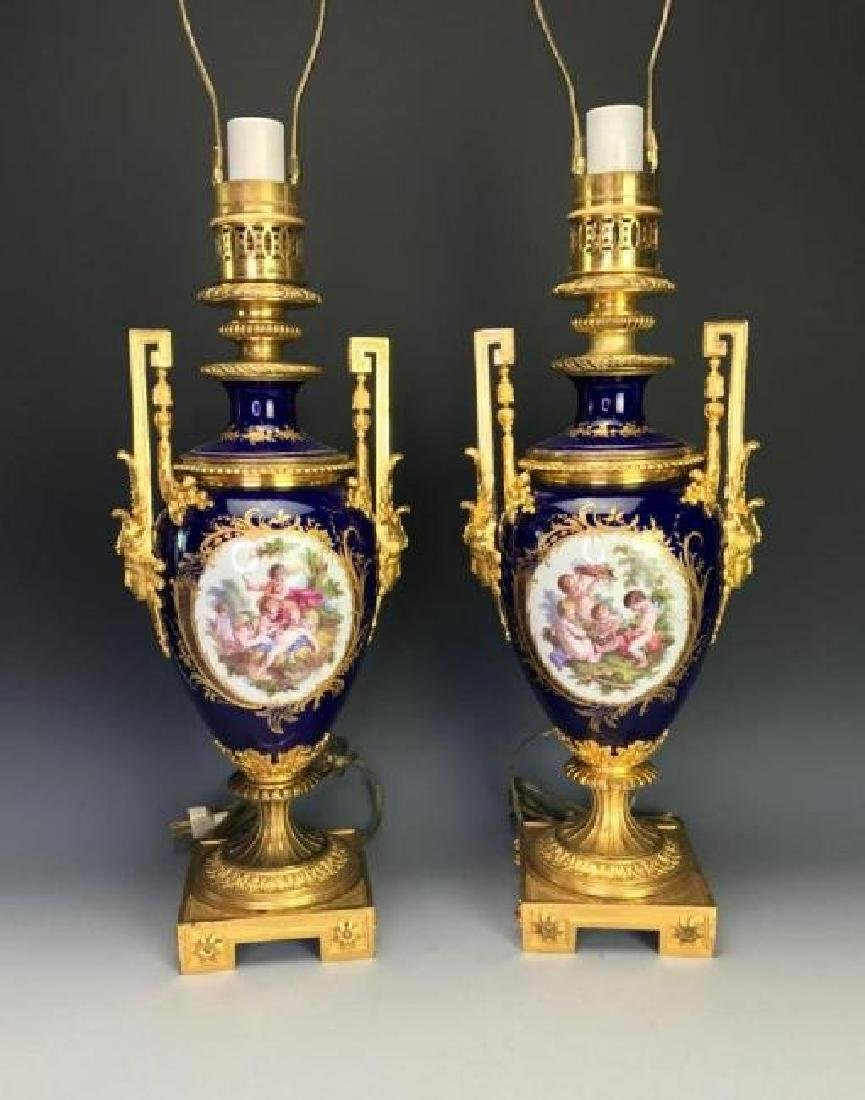 SUPERB PAIR OF ORMOLU MOUNTED SEVRES PORCLAIN LAMPS