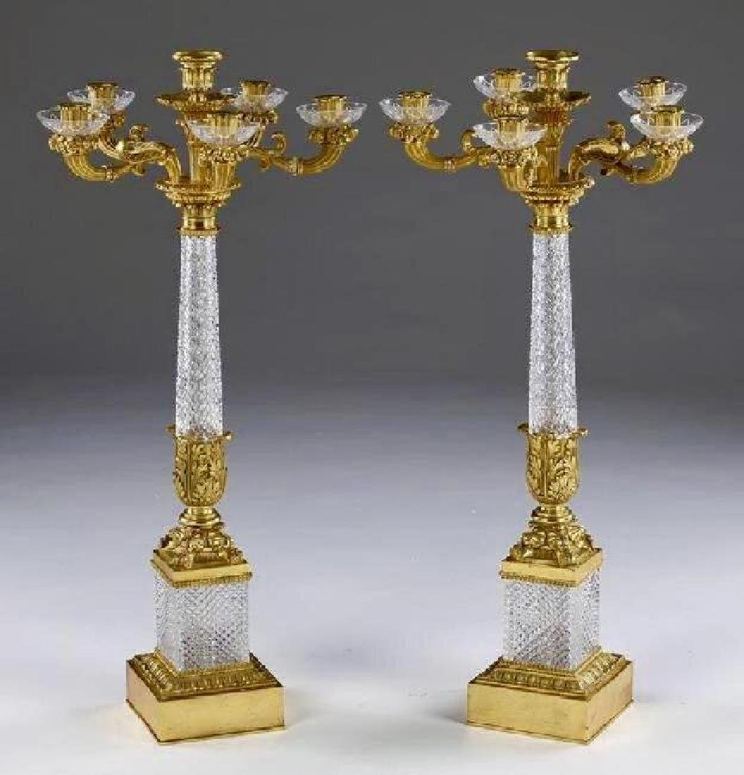 A PAIR OF DORE BRONZE AND BACCARAT CRYSTAL CANDELABRA