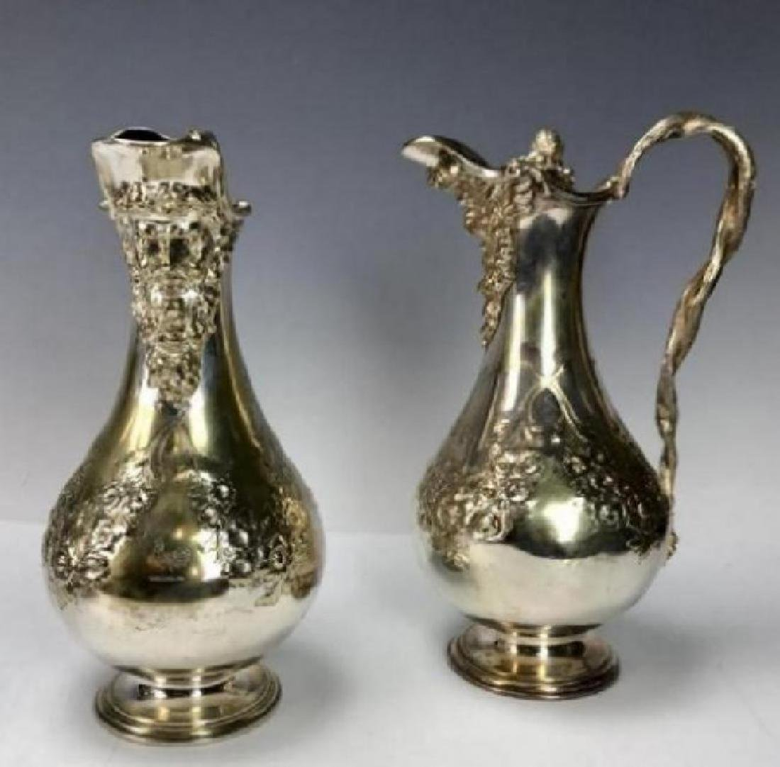 PAIR OF 19TH C. SILVERED EWERS - 2