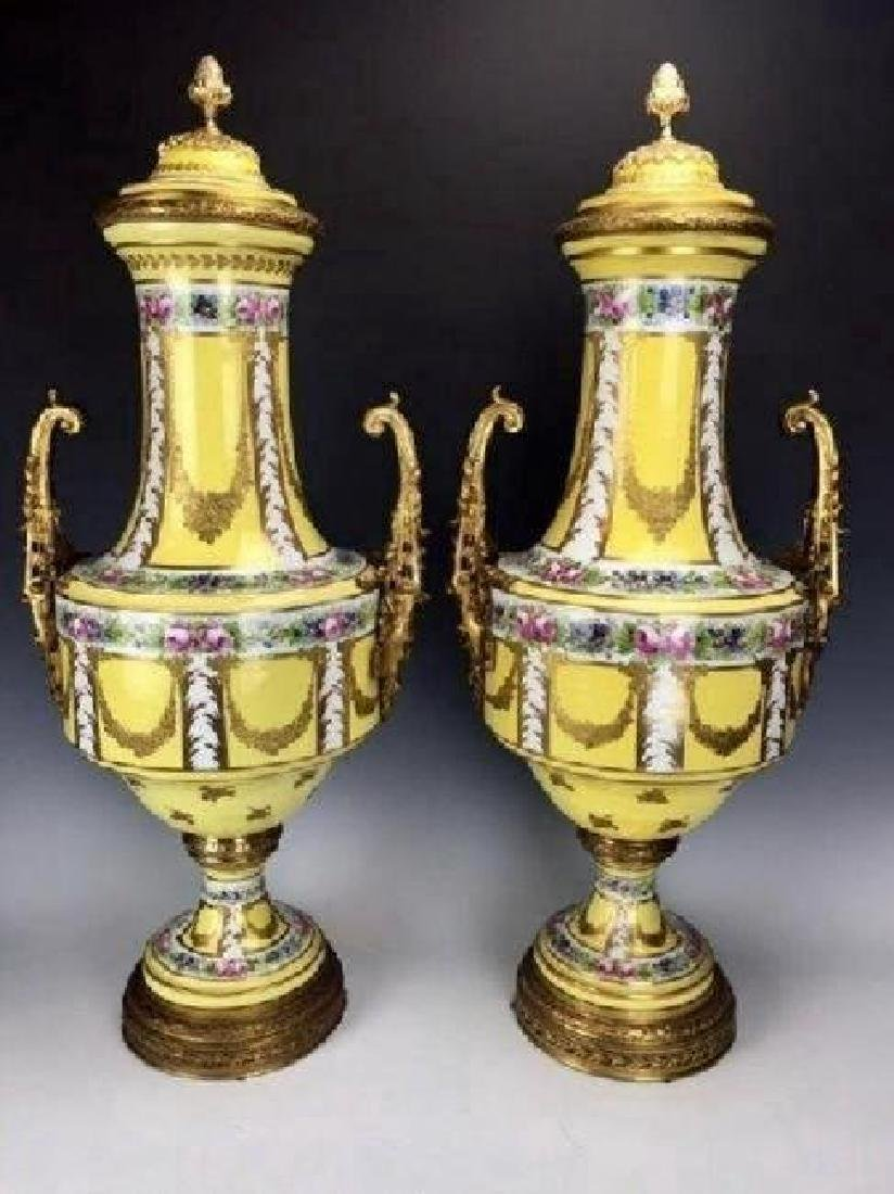 PAIR OF ORMOLU MOUNTED SEVRES STYLE PORCELAIN VASES