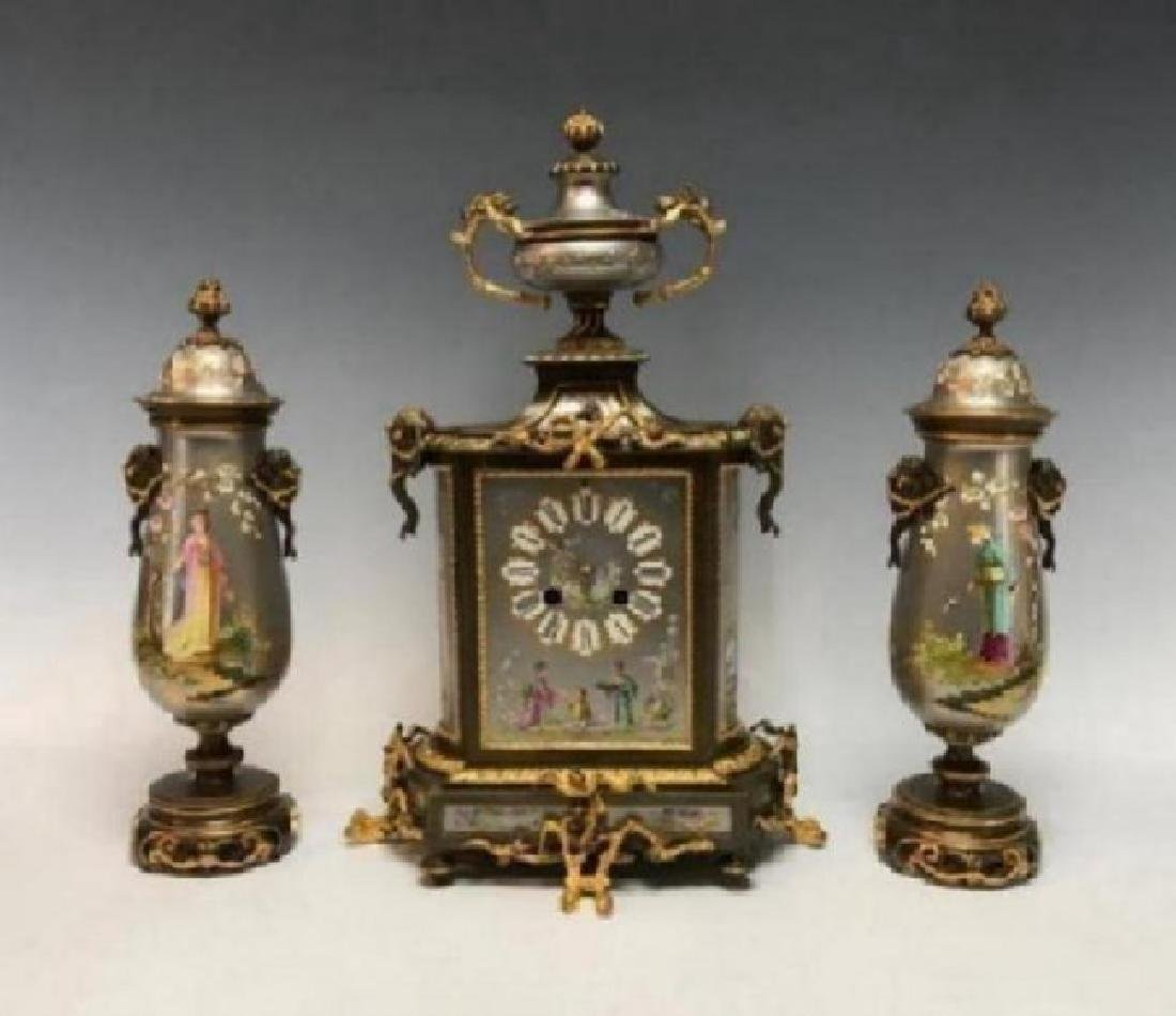 A NAPOLEON III FRENCH BRONZE AND PORCELAIN CLOCK SET