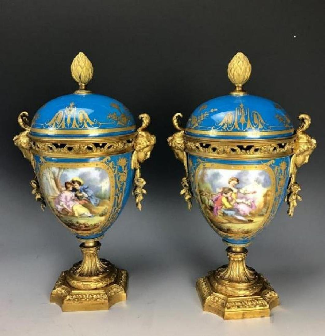 A PAIR OF 19TH C. ORMOLU MOUNTED SEVRES VASES