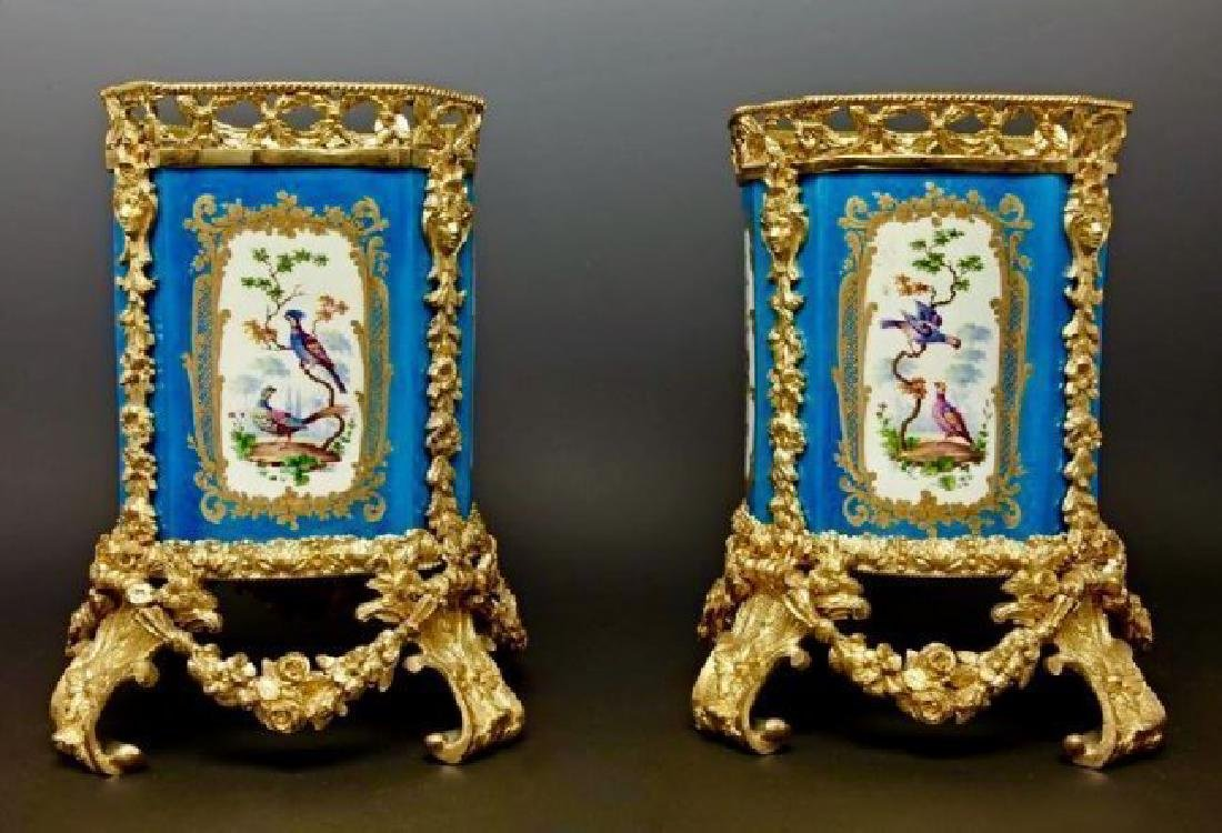 PAIR OF DORE BRONZE MOUNTED CELEST BLUE SEVRES VASES