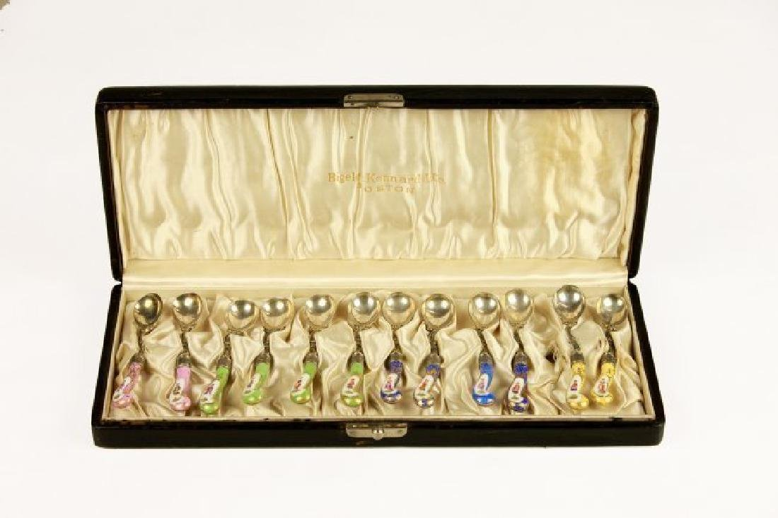 A SET OF 12 GERMAN SILVER AND PORCELAIN TEA SPOONS